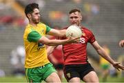 10 June 2018; Ryan McHugh of Donegal in action against Caolan Mooney of Down during the Ulster GAA Football Senior Championship Semi-Final match between Donegal and Down at St Tiernach's Park in Clones, Monaghan. Photo by Oliver McVeigh/Sportsfile