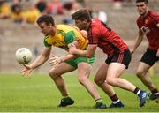 10 June 2018; Leo McLoone of Donegal in action against Anthony Doherty of Down  during the Ulster GAA Football Senior Championship Semi-Final match between Donegal and Down at St Tiernach's Park in Clones, Monaghan. Photo by Oliver McVeigh/Sportsfile