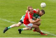 10 June 2018; Conor Grimes of Louth in action against Conor O'Neill during the GAA Football All-Ireland Senior Championship Round 1 match between London and Louth at McGovern Park in Ruislip, London. Photo by Matt Impey/Sportsfile