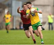 10 June 2018; Ryan McHugh of Donegal in action against Colm Flanagan of Down during the Ulster GAA Football Senior Championship Semi-Final match between Donegal and Down at St Tiernach's Park in Clones, Monaghan. Photo by Oliver McVeigh/Sportsfile