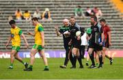 10 June 2018; Donegal manager Declan Bonner questioning Referee Anthony Nolan as they leave the pitch at half time in the Ulster GAA Football Senior Championship Semi-Final match between Donegal and Down at St Tiernach's Park in Clones, Monaghan. Photo by Oliver McVeigh/Sportsfile