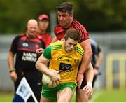 10 June 2018; Eoghan Bán Gallagher of Donegal  in action against Peter Turley of Down during the Ulster GAA Football Senior Championship Semi-Final match between Donegal and Down at St Tiernach's Park in Clones, Monaghan. Photo by Oliver McVeigh/Sportsfile