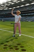 10 June 2018; Volunteers from the GAA Museum and the Croke Park Community team taking up sections of the Croke Park pitch following the Leinster GAA Football Championship Semi-Finals on Sunday 10th June. These unique potted pieces of Croke Park are now on sale for €10 in the GAA Museum gift shop for a limited period. All profits from the sale of these pots will go to the Official GAA Charities for 2018 – Mayo Roscommon Hospice Foundation, Cavan Monaghan Palliative Care, Kerry Hospice Foundation, Jack and Jill Children's Foundation and Concern. Pictured is Magda Constantinescu. Croke Park, Dublin. Photo by Piaras Ó Mídheach/Sportsfile