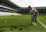 10 June 2018; Volunteers from the GAA Museum and the Croke Park Community team taking up sections of the Croke Park pitch following the Leinster GAA Football Championship Semi-Finals on Sunday 10th June. These unique potted pieces of Croke Park are now on sale for €10 in the GAA Museum gift shop for a limited period. All profits from the sale of these pots will go to the Official GAA Charities for 2018 – Mayo Roscommon Hospice Foundation, Cavan Monaghan Palliative Care, Kerry Hospice Foundation, Jack and Jill Children's Foundation and Concern. Pictured is Gemma Sexton, from Castleknock. Croke Park, Dublin. Photo by Piaras Ó Mídheach/Sportsfile