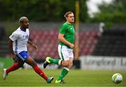 12 June 2018; Georgie Poynton of Ireland in action against Tidane Kaita of France during the College & Universities Football League match between Ireland and France at the City Calling Stadium in Longford. Photo by Eóin Noonan/Sportsfile