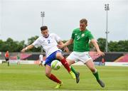 12 June 2018; Georgie Kelly of Ireland in action against Clement Tourtelot of France during the College & Universities Football League match between Ireland and France at the City Calling Stadium in Longford. Photo by Eóin Noonan/Sportsfile