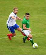 12 June 2018; Daire O'Connor of Ireland in action against Clément Bassin of France during the College & Universities Football League match between Ireland and France at the City Calling Stadium in Longford. Photo by Eóin Noonan/Sportsfile