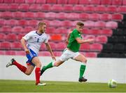 12 June 2018; Jamie Hollywood of Ireland in action against Vincent Roux of France during the College & Universities Football League match between Ireland and France at the City Calling Stadium in Longford. Photo by Eóin Noonan/Sportsfile