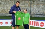 13 June 2018; The Irish ParaHockey ID team today announced Off The Ball as their shirt sponsor ahead of the European ParaHockey Tournament in Barcelona. ParaHockey ID and Irish Under 16 Coach Niall Denham presents Hannah Winston of Three Rock Rovers HC, Co. Dublin, with her jersey at the Three Rock Rovers HC, Grange Road in Rathfarnham, Dublin. Photo by Harry Murphy/Sportsfile