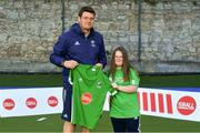 13 June 2018; The Irish ParaHockey ID team today announced Off The Ball as their shirt sponsor ahead of the European ParaHockey Tournament in Barcelona. ParaHockey ID and Irish Under 16 Coach Niall Denham presents Katie Reed of Three Rock Rovers, Co. Dublin, with her jersey at the Three Rock Rovers HC, Grange Road in Rathfarnham, Dublin. Photo by Harry Murphy/Sportsfile