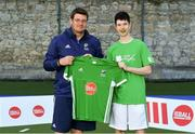 13 June 2018; The Irish ParaHockey ID team today announced Off The Ball as their shirt sponsor ahead of the European ParaHockey Tournament in Barcelona. ParaHockey ID and Irish Under 16 Coach Niall Denham presents Matthew Burke of Three Rock Rovers HC , Co. Dublin, with his jersey at the Three Rock Rovers HC, Grange Road in Rathfarnham, Dublin. Photo by Harry Murphy/Sportsfile