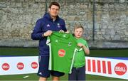 13 June 2018; The Irish ParaHockey ID team today announced Off The Ball as their shirt sponsor ahead of the European ParaHockey Tournament in Barcelona. ParaHockey ID and Irish Under 16 Coach Niall Denham presents Daniel Woods of Monkstown HC, Co. Dublin, with his jersey at the Three Rock Rovers HC, Grange Road in Rathfarnham, Dublin. Photo by Harry Murphy/Sportsfile