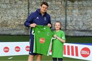 13 June 2018; The Irish ParaHockey ID team today announced Off The Ball as their shirt sponsor ahead of the European ParaHockey Tournament in Barcelona. ParaHockey ID and Irish Under 16 Coach Niall Denham presents Millie Walsh of Railway Union HC , Co. Dublin, with her jersey at the Three Rock Rovers HC, Grange Road in Rathfarnham, Dublin. Photo by Harry Murphy/Sportsfile