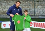 13 June 2018; The Irish ParaHockey ID team today announced Off The Ball as their shirt sponsor ahead of the European ParaHockey Tournament in Barcelona. ParaHockey ID and Irish Under 16 Coach Niall Denham presents Connor Brown of Monkstown HC, Co. Dublin, with his jersey at the Three Rock Rovers HC, Grange Road in Rathfarnham, Dublin. Photo by Harry Murphy/Sportsfile