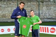 13 June 2018; The Irish ParaHockey ID team today announced Off The Ball as their shirt sponsor ahead of the European ParaHockey Tournament in Barcelona. ParaHockey ID and Irish Under 16 Coach Niall Denham presents Joe Whelan of Three Rock Rovers HC, Co. Dublin, with his jersey at the Three Rock Rovers HC, Grange Road in Rathfarnham, Dublin. Photo by Harry Murphy/Sportsfile