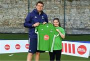 13 June 2018; The Irish ParaHockey ID team today announced Off The Ball as their shirt sponsor ahead of the European ParaHockey Tournament in Barcelona. ParaHockey ID and Irish Under 16 Coach Niall Denham presents Lia Gogarty of Railway Union HC , Co. Dublin, with her jersey at the Three Rock Rovers HC, Grange Road in Rathfarnham, Dublin. Photo by Harry Murphy/Sportsfile