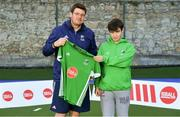 13 June 2018; The Irish ParaHockey ID team today announced Off The Ball as their shirt sponsor ahead of the European ParaHockey Tournament in Barcelona. ParaHockey ID and Irish Under 16 Coach Niall Denham presents Vincent William of Monkstown HC, Co. Dublin, with his jersey at the Three Rock Rovers HC, Grange Road in Rathfarnham, Dublin. Photo by Harry Murphy/Sportsfile