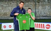 13 June 2018; The Irish ParaHockey ID team today announced Off The Ball as their shirt sponsor ahead of the European ParaHockey Tournament in Barcelona. ParaHockey ID and Irish Under 16 Coach Niall Denham presents Louis Olden of Monkstown HC, Co. Dublin, with his jersey at the Three Rock Rovers HC, Grange Road in Rathfarnham, Dublin. Photo by Harry Murphy/Sportsfile