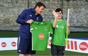 13 June 2018; The Irish ParaHockey ID team today announced Off The Ball as their shirt sponsor ahead of the European ParaHockey Tournament in Barcelona. ParaHockey ID and Irish Under 16 Coach Niall Denham presents Mcdara Lambertini of Railway Union HC, Co. Dublin, with his jersey at the Three Rock Rovers HC, Grange Road in Rathfarnham, Dublin. Photo by Harry Murphy/Sportsfile