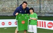 13 June 2018; The Irish ParaHockey ID team today announced Off The Ball as their shirt sponsor ahead of the European ParaHockey Tournament in Barcelona. ParaHockey ID and Irish Under 16 Coach Niall Denham presents Elina Doyle of Three Rock Rovers HC , Co. Dublin, with her jersey at the Three Rock Rovers HC, Grange Road in Rathfarnham, Dublin. Photo by Harry Murphy/Sportsfile