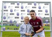 13 June 2018; Róisín Casey, aged 10, from Castlegar, Co. Galway, presents Seán Loftus of Galway with his Bord Gáis Energy Man of the Match award following the meeting of Offaly and Galway in O'Connor Park, Tullamore. Bord Gáis Energy offers its customers unmissable rewards throughout the Championship season, including match tickets and hospitality, access to training camps with Hurling stars and the opportunity to present Man of the Match Awards at U-21 games. Photo by Piaras Ó Mídheach/Sportsfile