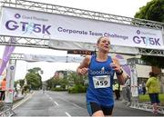 13 June 2018; Jill Hodgins of Goodbody Stockbrokers, first female finisher, after crossing the finish line the Grant Thornton Corporate 5K Team Challenge in Cork City, Cork.  Photo by Matt Browne/Sportsfile