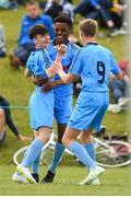 15 June 2018; Ben Quinn of DDSL celebrates with teammates Glory Nzinga, centre, and Evan Ferguson after scoring his side's fourth goal in the Kennedy Cup Final match between DDSL and Kildare during the SFAI Kennedy Cup Finals at University of Limerick, Limerick. Photo by Tom Beary/Sportsfile