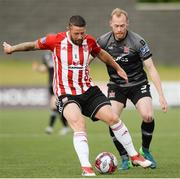 15 June 2018; Rory Patterson of Derry City  in action against Chris Sheilds of Dundalk during the SSE Airtricity League Premier Division match between Derry City and Dundalk at the Brandywell Stadium, Derry. Photo by Oliver McVeigh/Sportsfile