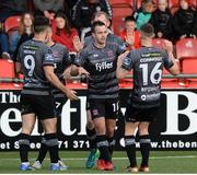 15 June 2018; Robbie Benson of Dundalk, centre, celebrates with team-mates after scoring his side's first goal during the SSE Airtricity League Premier Division match between Derry City and Dundalk at the Brandywell Stadium in Derry. Photo by Oliver McVeigh/Sportsfile