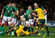 16 June 2018; Dan Leavy of Ireland  is tackled by Brandon Paenga-Amosa, left, and Kurtley Beale of Australia  during the 2018 Mitsubishi Estate Ireland Series 2nd Test match between Australia and Ireland at AAMI Park, in Melbourne, Australia. Photo by Brendan Moran/Sportsfile