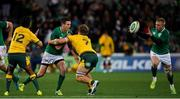 16 June 2018; Jonathan Sexton of Ireland offloads to team-mate Keith Earls, right, as he is tackled by Kurtley Beale and Michael Hooper of Australia during the 2018 Mitsubishi Estate Ireland Series 2nd Test match between Australia and Ireland at AAMI Park, in Melbourne, Australia. Photo by Brendan Moran/Sportsfile