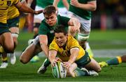 16 June 2018; Bernard Foley of Australia is tackled by Garry Ringrose of Ireland during the 2018 Mitsubishi Estate Ireland Series 2nd Test match between Australia and Ireland at AAMI Park, in Melbourne, Australia. Photo by Brendan Moran/Sportsfile