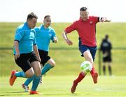 16 June 2018; Wayne O'Callaghan of Munster 1 in action against Patrick Furlong of Eastern 1 during the Special Olympics 2018 Ireland Games at the FAI National Training Centre in Abbotstown, Dublin. Photo by Ramsey Cardy/Sportsfile