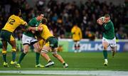 16 June 2018; Keith Earls of Ireland takes a pass from team-mate Jonathan Sexton of Ireland as he is tackled by Kurtley Beale and Michael Hooper of Australia during the 2018 Mitsubishi Estate Ireland Series 2nd Test match between Australia and Ireland at AAMI Park, in Melbourne, Australia. Photo by Brendan Moran/Sportsfile