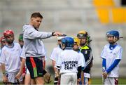 16 June 2018; Bord Gáis Energy Rewards Club winners attended the Bord Gáis Energy #HurlingToTheCore training camp in Páirc Uí Chaoimh today where they had the chance to meet hurling stars and Bord Gáis Energy ambassadors Alan Cadogan of Cork, Paudie Feehan of Tipperary and Fergal Whitely of Dublin. Pictured is Alan Cadogan of Cork with players during the camp. All attendees were members of the Bord Gáis Energy Rewards Club, which offers its customers unmissable rewards throughout the Championship season, including match tickets and hospitality, access to training camps with Hurling stars and the opportunity to present Man of the Match Awards at U-21 games during the 2018 BGE #HurlingToTheCore training camp at Páirc Uí Chaoimh in Ballintemple, Cork. Photo by Eóin Noonan/Sportsfile
