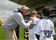 16 June 2018; Bord Gáis Energy Rewards Club winners attended the Bord Gáis Energy #HurlingToTheCore training camp in Páirc Uí Chaoimh today where they had the chance to meet hurling stars and Bord Gáis Energy ambassadors Alan Cadogan of Cork, Paudie Feehan of Tipperary and Fergal Whitely of Dublin. Pictured is former cork player Ger Cunningham signing autographs after the camp. All attendees were members of the Bord Gáis Energy Rewards Club, which offers its customers unmissable rewards throughout the Championship season, including match tickets and hospitality, access to training camps with Hurling stars and the opportunity to present Man of the Match Awards at U-21 games during the 2018 BGE #HurlingToTheCore training camp at Páirc Uí Chaoimh in Ballintemple, Cork. Photo by Eóin Noonan/Sportsfile