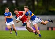 16 June 2018; Chris Og Jones of Cork in action against Conn Bonnar of Tipperary during the EirGrid Munster GAA Football U20 Championship quarter-final match between Cork and Tipperary at Páirc UÍ Rinn, Cork. Photo by Eóin Noonan/Sportsfile