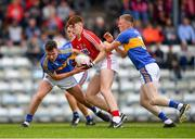 16 June 2018; Mark Keane of Cork in action against Gavin Whelan, left, and Jack Harney of Tipperary during the EirGrid Munster GAA Football U20 Championship quarter-final match between Cork and Tipperary at Páirc UÍ Rinn, Cork. Photo by Eóin Noonan/Sportsfile