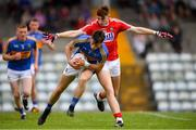 16 June 2018; Gavin Whelan of Tipperary in action against Mark Keane of Cork during the EirGrid Munster GAA Football U20 Championship quarter-final match between Cork and Tipperary at Páirc UÍ Rinn, Cork. Photo by Eóin Noonan/Sportsfile