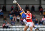 16 June 2018; Gavin Ryan of Tipperary in action against Mark Keane of Cork during the EirGrid Munster GAA Football U20 Championship quarter-final match between Cork and Tipperary at Páirc UÍ Rinn, Cork. Photo by Eóin Noonan/Sportsfile