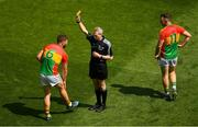 10 June 2018; Daniel St Ledger of Carlow is shown the yellow card by referee Fergal Kelly as team-mate Darragh Foley looks on during the Leinster GAA Football Senior Championship Semi-Final match between Carlow and Laois at Croke Park in Dublin. Photo by Piaras Ó Mídheach/Sportsfile