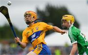 17 June 2018; Mike Gough of Clare in action against Cian Casey of Limerick during the Electric Ireland Munster GAA Hurling Minor Championship Round 5 match between Clare and Limerick at Cusack Park in Ennis, Clare. Photo by Ray McManus/Sportsfile