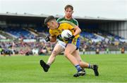 17 June 2018; Brian Derwin of Roscommon in action against John Cunnane of Mayo during the EirGrid Connacht GAA Football U20 Championship Final match between Mayo and Roscommon at Dr Hyde Park in Roscommon. Photo by Ramsey Cardy/Sportsfile