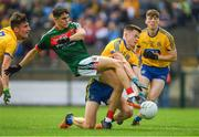 17 June 2018; Tommy Conroy of Mayo is tackled by Aidan Dowd of Roscommon, supported by team-mate Luke Mollahan, left, and Damien Duff during the EirGrid Connacht GAA Football U20 Championship Final match between Mayo and Roscommon at Dr Hyde Park in Roscommon. Photo by Piaras Ó Mídheach/Sportsfile