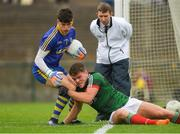 17 June 2018; Roscommon goalkeeper Aaron Brady is tackled by Jordan Flynn of Mayo during the EirGrid Connacht GAA Football U20 Championship Final match between Mayo and Roscommon at Dr Hyde Park in Roscommon. Photo by Piaras Ó Mídheach/Sportsfile