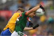17 June 2018; Tommy Conroy of Mayo in action against Damien Duff of Roscommon during the EirGrid Connacht GAA Football U20 Championship Final match between Mayo and Roscommon at Dr Hyde Park in Roscommon. Photo by Piaras Ó Mídheach/Sportsfile