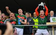 17 June 2018; Ryan O'Donoghue of Mayo lifts the cup following the EirGrid Connacht GAA Football U20 Championship Final match between Mayo and Roscommon at Dr Hyde Park in Roscommon. Photo by Ramsey Cardy/Sportsfile