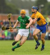 17 June 2018; Seamus Flanagan of Limerick in action against David McInerney of Clare during the Munster GAA Hurling Senior Championship Round 5 match between Clare and Limerick at Cusack Park in Ennis, Clare. Photo by Ray McManus/Sportsfile