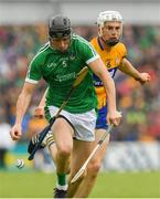 17 June 2018; Diarmaid Byrnes of Limerick in action against Conor Cleary of Clare during the Munster GAA Hurling Senior Championship Round 5 match between Clare and Limerick at Cusack Park in Ennis, Clare. Photo by Ray McManus/Sportsfile