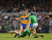 17 June 2018; John Conlon of Clare in action against Mike Casey of Limerick, 3, during the Munster GAA Hurling Senior Championship Round 5 match between Clare and Limerick at Cusack Park in Ennis, Clare. Photo by Ray McManus/Sportsfile
